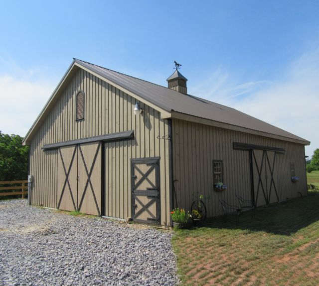 Horse barn with large door